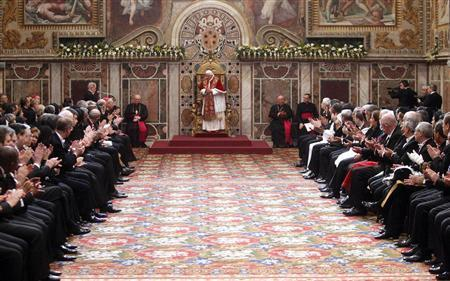 Pope Benedict XVI is welcomed during an audience with the diplomatic corps at the Vatican