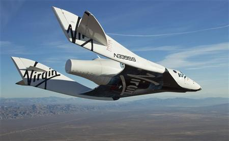 The Virgin Galactic SpaceShip2 glides toward Earth on its first test flight over Mojave, California