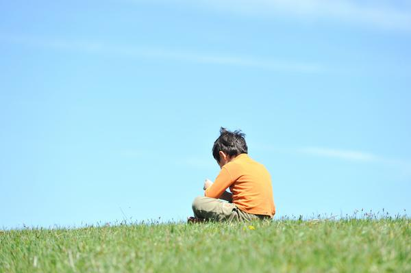 boy-sitting-alone-120123