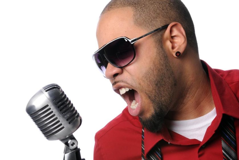 Man Singing Into Vintage Microphone
