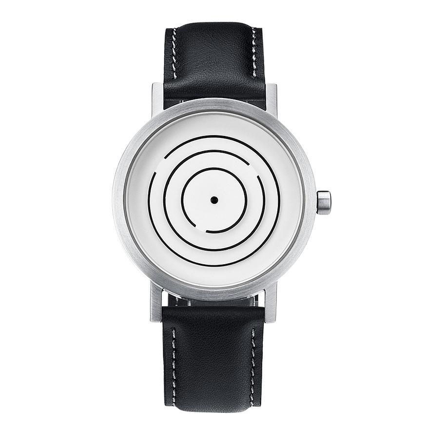 2d41eeb9c93 Os anéis deste relógio tem uma interrupção que marca a posição em que  estaria o ponteiro.